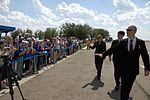 Soyuz MS-01 crew members wave to schoolchildren after arriving in Baikonur.jpg