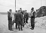Spitfire pilots of No. 19 Squadron RAF gather at Manor Farm, Fowlmere, near Duxford in Cambridgeshire, September 1940. CH1370.jpg