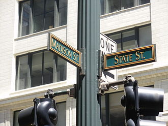 Madison Street (Chicago) - Madison Street and State Street, the intersection from which Chicago's numbering system is based.