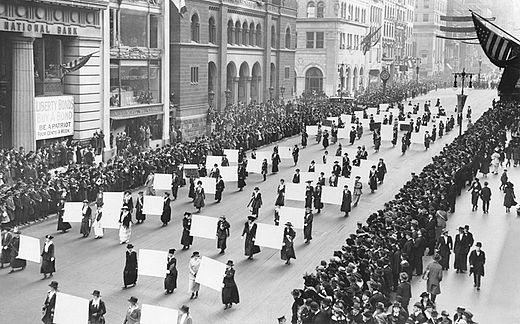 Women's suffragists parade in New York City in 1917, carrying placards with signatures of more than a million women. Suffragists Parade Down Fifth Avenue, 1917.JPG