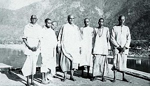 Chinmayananda Saraswati - Chinmayananda on the day of his Sannyas initiation, standing on the right of Sivananda Saraswati and other disciples, 25 February 1949, Maha Shivratri Day, Rishikesh.