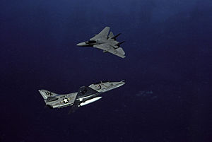 Dissimilar air combat training - A US Navy Douglas TA-4F Skyhawk and a Grumman F-14 Tomcat, both belonging to VFC-13, engage in dissimilar air combat training