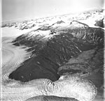 Taku and Hole-in-the-Wall Glaciers, tidewater glacier terminus and icefall in the foreground, and firn line in the background (GLACIERS 6243).jpg