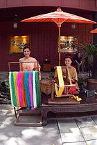 Thai Woman at Silk looms Jim Thompson House photo D Ramey Logan