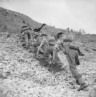 King's Own Yorkshire Light Infantry - Men of the 1st Battalion, King's Own Yorkshire Light Infantry climb a steep hill in Italy, November 1943.