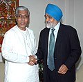 The Chief Minister of Tripura, Shri Manik Sarkar meeting the Deputy Chairman, Planning Commission, Shri Montek Singh Ahluwalia to finalize the Annual Plan outlay for 2011-12 of the State, in New Delhi on March 24, 2011.jpg