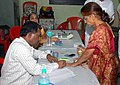 The Polling officer administering indelible ink at the finger of a female voter at a polling booth, in Mumbai, during the 4th phase of General Election-2009, on May 07, 2009.jpg