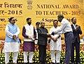 The President, Shri Pranab Mukherjee presenting the National Award for Teachers-2015 to Shri M. Kunhi Koya (Lakshadweep), on the occasion of the 'Teachers Day', in New Delhi.jpg