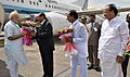 The Prime Minister, Shri Narendra Modi being received by the Governor of Andhra Pradesh and Telangana, Shri E.S.L. Narasimhan and the Chief Minister of Telangana, Shri K. Chandrasekhar Rao, on his arrival, in Telangana.jpg