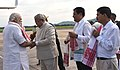 The Prime Minister, Shri Narendra Modi being received by the Governor of Assam, Nagaland & Tripura, Shri P.B. Acharya and other dignitaries on his arrival, at Guwahati Airport on May 24, 2016.jpg