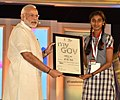 The Prime Minister, Shri Narendra Modi distributing the certificate to MyGov contest winner, at the 2nd Year Anniversary celebrations of MyGov, in New Delhi on August 06, 2016 (2).jpg