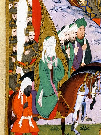 Military career of Muhammad - 16th century illustration of Muhammad (depicted as veiled and surrounded by flames) supervising the Battle of Uhud