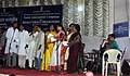 """The artists of Song & Drama Division presenting a song at a function on"""" Sarva Siksha Abhiyan"""" on""""Bharat Nirmaan"""" on the occasion of the Public Information Campaign organised by Press Information Bureau Guwahati at South.jpg"""