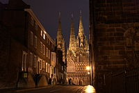 The entrance to Cathedral Close, Lichfield, with Lichfield Cathedral in the background.jpg