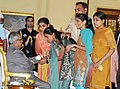 The visually-impaired girls tying 'Rakhi' to the President, Shri Pranab Mukherjee, on the occasion of 'Raksha Bandhan', in New Delhi on August 02, 2012.jpg