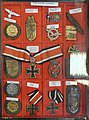 Third Reich Nazi Germany Military decorations Badges Norwegian descriptions Iron cross Narvik shield etc Lofoten Krigsminnemuseum WW2 Museum Norway 2019-05-08 DSC09822 Cropped Adjusted perspective.jpg
