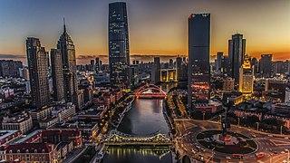 Tianjin-city-night-river-bridge-skyscrapers-HDR-style-China 2560x1440.jpg