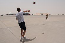 Brady playing catch with a U.S. Air Force airman at Al Udeid Air Base in Qatar in 2018