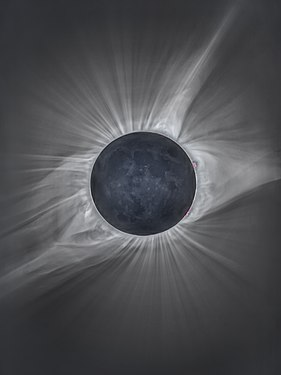 Black-and-white photograph of the August 2017 total solar eclipse, the Sun's corona lashing around the Moon