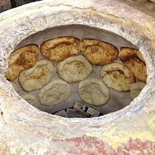 Traditional georgian bread (tonis puri).jpg