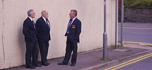 Treorchy Male Choir - Members of the choir in blazer and tie awaiting a bus (2008)