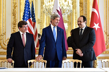 Davutoglu (left) with US Secretary of State John Kerry (centre) and Qatari Foreign Minister Khalid al-Attiyah (right) discussing Israel-Hamas ceasefire deal (Paris, 2014) Turkish Foreign Minister Davutoglu, U.S. Secretary Kerry and Qatari Foreign Minister Al Attiyah.jpg
