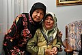 Two Muslim women in tudungs at an engagement party, Brunei - 20100531-02.jpg