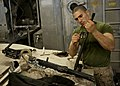 U.S. Marine Corps Lance Cpl. Vincent Russo, with the 24th Marine Expeditionary Unit (MEU), cleans an M240B medium machine gun aboard the amphibious transport dock ship USS New York (LPD 21) April 12, 2012, while 120412-N-XK513-032.jpg