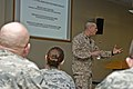 U.S. Marine Corps Sgt. Maj. Bryan B. Battaglia, the senior enlisted adviser to the chairman of the Joint Chiefs of Staff, speaks to U.S. Soldiers and Airmen with the Illinois National Guard at the 182nd Airlift 130406-Z-EU280-022.jpg