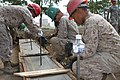 U.S. Marines with the 9th Engineer Support Battalion, 3rd Marine Logistics Group, III Marine Expeditionary Force remove frames from new concrete during renovation work on the Erdmiin Oyun School July 25, 2013 130725-M-DR618-021.jpg