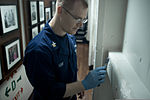 U.S. Navy Cryptologic Technician (Collection) 1st Class Joseph Gray repairs lagging aboard the guided missile destroyer USS Stockdale (DDG 106) July 26, 2013, in the U.S. 5th Fleet area of responsibility 130726-N-HN991-003.jpg