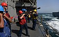 U.S. Navy Gunner's Mate 3rd Class Cheyenne Stiles, center, fires a shot line from the guided missile cruiser USS Gettysburg (CG 64) to the dry cargo and ammunition ship USNS Alan Shepard (T-AKE 3) during 131002-N-MY642-020.jpg
