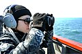 U.S. Navy Seaman Darlene Fernandez stands watch on the bridge wing of the guided missile destroyer USS McCampbell (DDG 85) March 14, 2013, in the Yellow Sea 130314-N-TG831-168.jpg