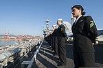 U.S. Sailors man the rails aboard the aircraft carrier USS George Washington (CVN 73) as the ship arrives in Busan, South Korea, Oct. 4, 2013 131004-N-IP531-092.jpg