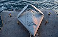 U.S. Sailors move a U.S. Navy X-47B Unmanned Combat Air System demonstrator aircraft onto an aircraft elevator aboard the aircraft carrier USS George H.W. Bush (CVN 77) May 14, 2013, in the Atlantic Ocean 130514-N-FU443-025.jpg