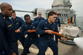 U.S. Sailors participate in fire hose handling training aboard the guided missile cruiser USS Hue City (CG 66) May 1, 2013, in the U.S. 5th Fleet area of responsibility 130501-N-OC961-096.jpg