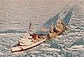 USCGC Edisto (WAGB-284) escorting cargo vessel in polar ice. Post October 1968. HH-52A helo hovering over flight deck..jpg