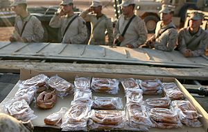 Ar-Rutbah - U.S. Marines celebrate the Marine Corps' birthday by eating doughnuts at Ar-Rutbah in 2009