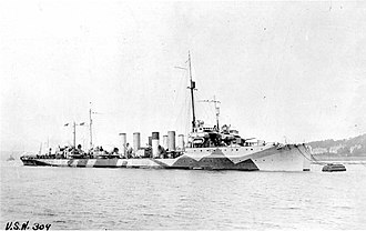 """USS Cassin (DD-43) - USS Cassin (DD-43) moored alongside another U.S. Navy destroyer, at Queenstown, Ireland, circa 1918. She is painted in """"Dazzle"""" type camouflage."""