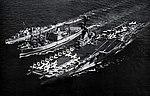 USS Suribachi (AE-21) replenishing USS Shangri-La (CVA-38) and USS Zellars (DD-777) in the Mediterranean Sea, in 1968.jpg