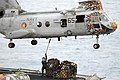 US Navy 030321-N-6020P-015 A Sailor aboard fast combat support ship USS Rainier (AOE 7) attaches a cargo hook to a CH-46 Sea Knight assigned to the Gunbearers of Helicopter Combat Support Squadron Elevenn Detachment Five (HC-1.jpg