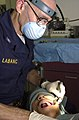 US Navy 030324-N-6536T-005 U.S. Navy Dentist Capt. John Labanc, from Hillsburrow, Ill., extracts a wisdom tooth.jpg