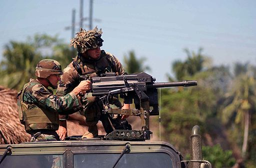 US Navy 030414-N-6501M-013 U.S. Navy Captain David T. Pittelkow, Commanding Officer for the Joint Special Operation Task Force - Philippines (JSOTF-P), fires a Mark-19, 40mm grenade launcher