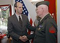 US Navy 030421-N-6901L-004 Congressman Rick Larsen shakes the hand of World War II veteran Cpl. John Wright who was awarded the Purple Heart.jpg