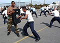 US Navy 040303-N-9362D-503 Master-at-Arms 2nd Class Danny Jenrette trains a student assigned to USS Theodore Roosevelt's (CVN 71) Ship's Self Defense Force (SSDF).jpg