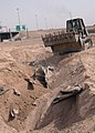US Navy 040504-N-1261P-016 U.S. Navy Seabees assigned to Naval Mobile Construction Battalion Seven Four (NMCB-74) help clean up a section of highway near Fallujah, Iraq.jpg