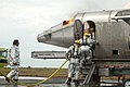 US Navy 040714-N-8770A-140 Firefighters extinguish a fire on the Mobile Aircraft Firefighter Training Device.jpg