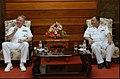 US Navy 040728-N-8796S-380 Commanding Officer, USS Curtis Wilbur (DDG 54), Cdr. John T. Lauer III, enjoys a friendly conversation with Vietnam's Navy Region Three Deputy Commander, Senior Captain, Phan Van Quoc upon arriving i.jpg
