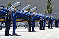 US Navy 040805-N-6477M-190 Pilots and Maintenance Personnel assigned to the Blue Angels Maintenance and Support Team stand at parade rest in front of their F-A-18 Hornets.jpg