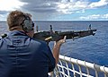 US Navy 041122-N-4166B-015 A Gunner's Mate, assigned to the guided missile destroyer USS Benfold (DDG 65) shoots an M-60 machine gun during a live fire training exercise.jpg